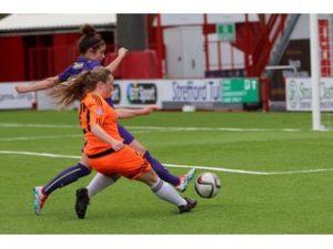 Citys Erin Cuthbert shoots under pressure from Hibs Emma Brownlie